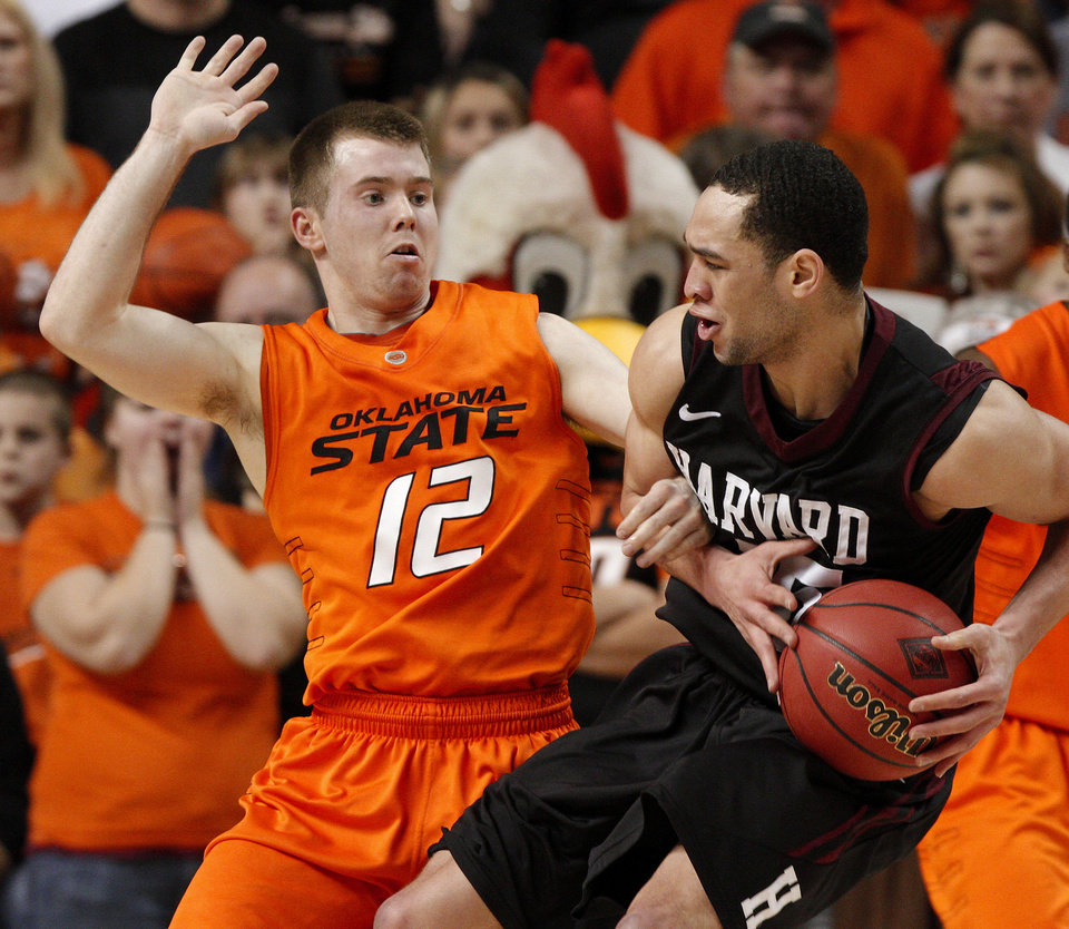 Oklahoma State's Keiton Page (12) defends Harvard's Christian Webster (15) during a first-round NIT college basketball game between Oklahoma State University (OSU) and Harvard at Gallagher-Iba Arena in Stillwater, Okla., Tuesday, March 15, 2011. Photo by Bryan Terry, The Oklahoman