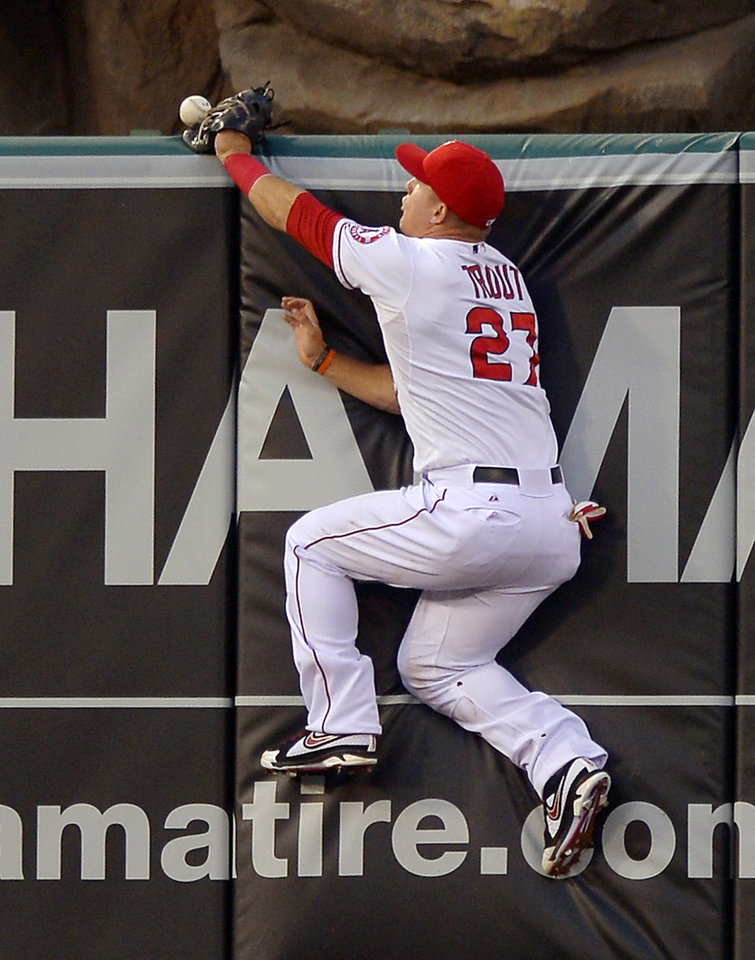 Photo - Los Angeles Angels center fielder Mike Trout can't get to a ball hit for a two-run home run by St. Louis Cardinals' Jon Jay during the second inning of a baseball game, Wednesday, July 3, 2013, in Anaheim, Calif. (AP Photo/Mark J. Terrill)