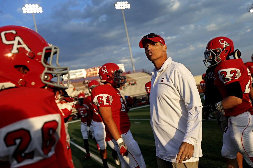 Carl Albert assistant coach Mike Corley talks with Carl Albert players before a high school football game between Carl Albert and Coweta in Midwest City, Friday, September 7, 2012.