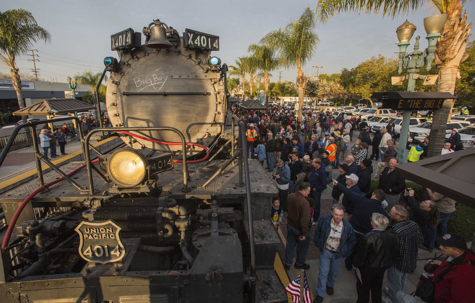 Photo - Spectators view the historic locomotive, Union Pacific Big Boy No. 4014 at Metrolink Station, Sunday, Jan. 26, 2014, in Covina, Calif. The locomotive will head for Colton over the next several weeks before No. 4014 departs for Union Pacific's Heritage Fleet Operations headquarters in Cheyenne, Wyo. (AP Photo/Ringo H.W. Chiu)
