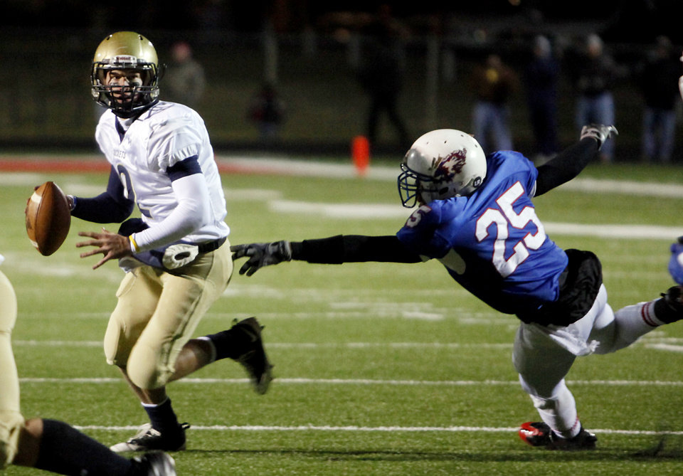 Kingfisher's Derek Patterson (2) gets past Millwood's Larry Seals (25) during the Class 2A State semifinal football game between Millwood High School and Kingfisher High School on Saturday, Dec. 5, 2009, in Yukon, Okla. 