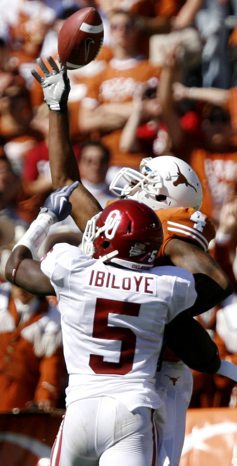 Photo - Oklahoma's Joseph Ibiloye (5) is called for pass interference as he defends on Texas' Dan Buckner (4) during the Red River Rivalry college football game between the University of Oklahoma Sooners (OU) and the University of Texas Longhorns (UT) at the Cotton Bowl in Dallas, Texas, Saturday, Oct. 17, 2009. Photo by Chris Landsberger, The Oklahoman