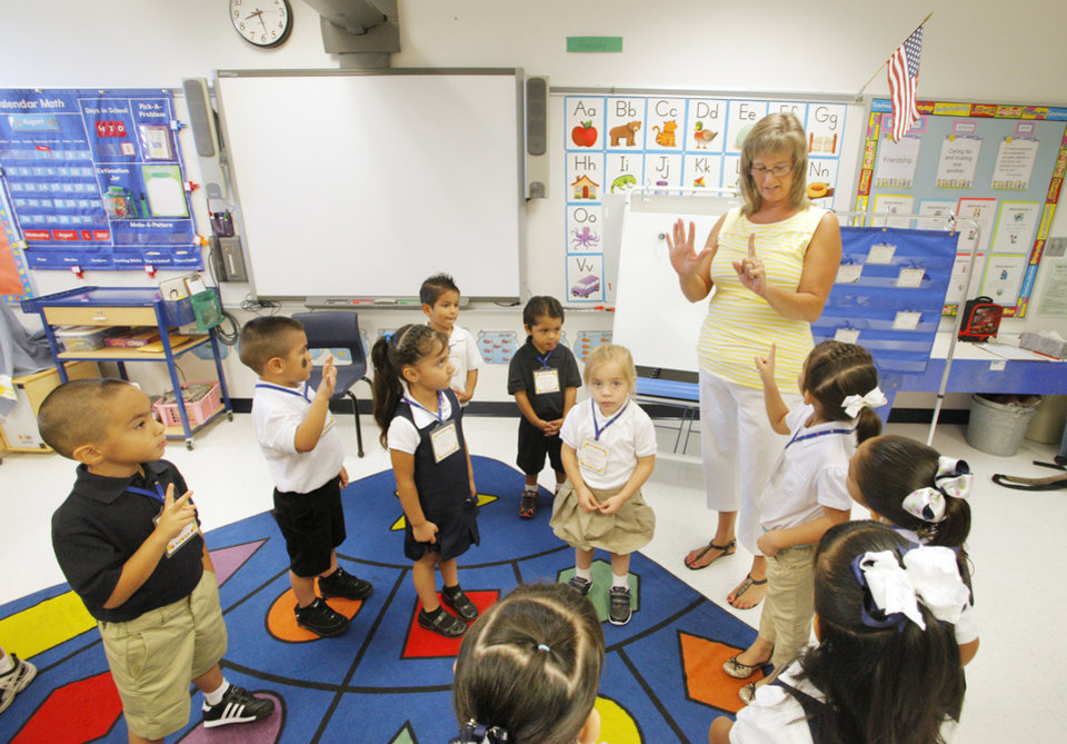 Photo - Prekindergarten teacher Anne Campbell counting with her students as classes start for the day at Adams Elementary in Oklahoma City Wednesday, Aug. 1, 2012. Wednesday was the first day of classes in the Oklahoma City Public School District.  Photo by Paul B. Southerland, The Oklahoman