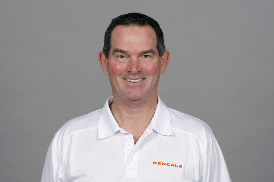 Photo - FILE - This is a 2013 file photo showing Mike Zimmer of the Cincinnati Bengals NFL football team. The Minnesota Vikings have chosen  Zimmer as their new head coach, according to multiple media reports. Zimmer will replace Leslie Frazier, who was fired after the team finished 5-10-1 this season. (AP Photo/File)