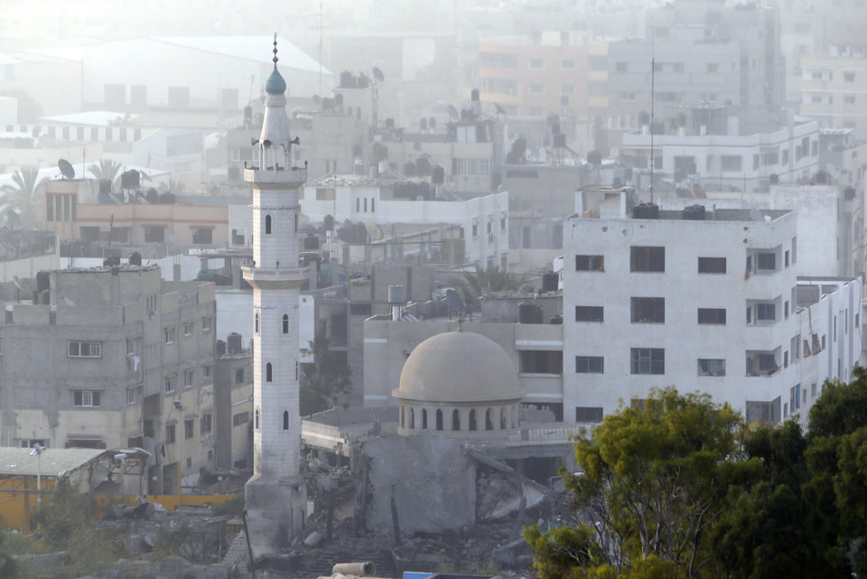 Photo - Damage can be seen at Al Aqsa Martyrs mosque in Gaza City after an Israeli strike, Tuesday, July 22, 2014. A police spokesman said Israeli aircraft have hit dozens of targets in the Gaza Strip, including the home of the late leader of Hamas' military wing, sevenral mosques and a football stadium. (AP Photo/Lefteris Pitarakis)