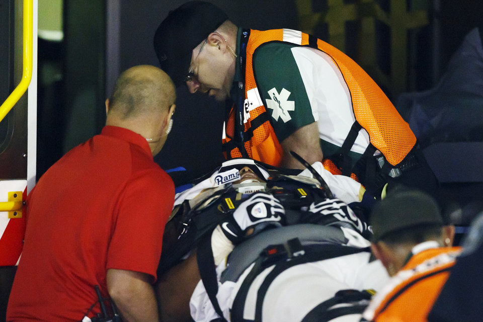 Photo -   St. Louis Rams tackle Rodger Saffold (76) is loaded into an ambulance after getting injured in the fourth quarter of an NFL football game against the Detroit Lions in Detroit, Sunday, Sept, 9, 2012. (AP Photo/Rick Osentoski)