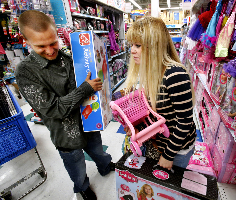 Trevor Fernandez and Brittany Pistole shop at Toys R Us as they open at 8:00 p.m. on Thanksgiving for Black Friday Sales on Thursday, Nov. 22, 2012, in Norman, Okla.  Photo by Steve Sisney, The Oklahoman ORG XMIT: OKC1211222122488581