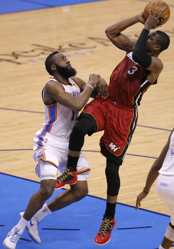 Miami's Dwyane Wade (3) shoots the ball beside Oklahoma City's James Harden (13) during Game 1 of the NBA Finals between the Oklahoma City Thunder and the Miami Heat at Chesapeake Energy Arena in Oklahoma City, Tuesday, June 12, 2012. Photo by Sarah Phipps, The Oklahoman