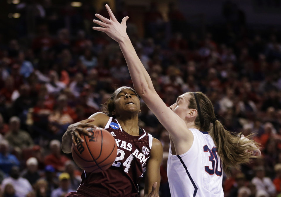 Photo - Texas A&M's Jordan Jones (24) wins a rebound against Connecticut's Breanna Stewart (30) during the first half of a regional final game in the NCAA college basketball tournament in Lincoln, Neb., Monday, March 31, 2014. (AP Photo/Nati Harnik)