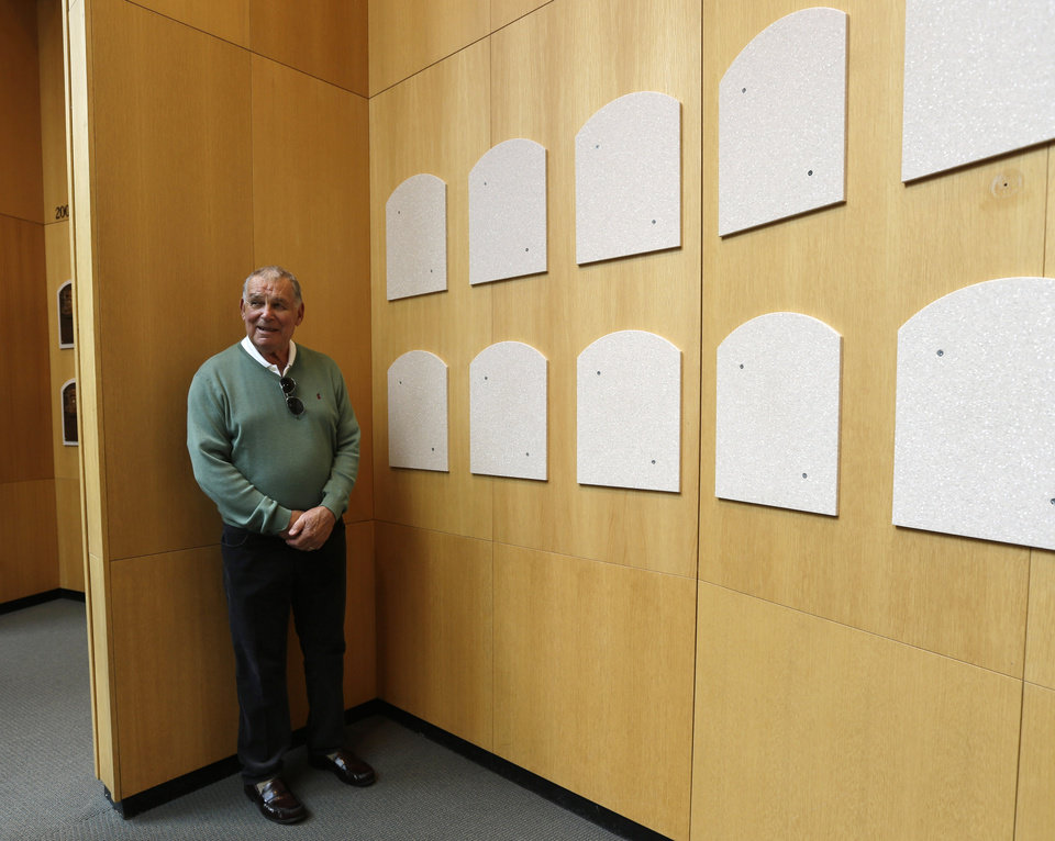 Photo - Former Atlanta Braves manager Bobby Cox poses for a photo where his plaque will be displayed during his orientation visit at the Baseball Hall of Fame on Monday, March 24, 2014, in Cooperstown, N.Y. Cox will be inducted to the hall in July. (AP Photo/Mike Groll)