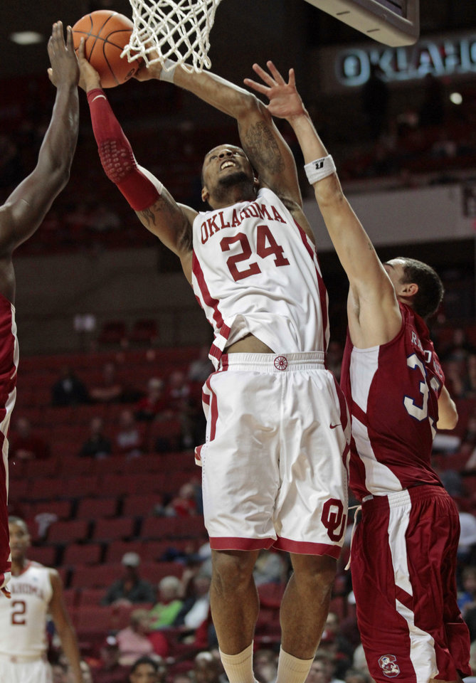 Photo - Oklahoma Sooners' Romero Osby (24) shoots in the second half as the University of Oklahoma (OU) Sooners defeat the South Carolina State Bulldogs 83-48 in men's college basketball at the Lloyd Noble Center on Wednesday, Dec. 21, 2011, in Norman, Okla.  Photo by Steve Sisney, The Oklahoman
