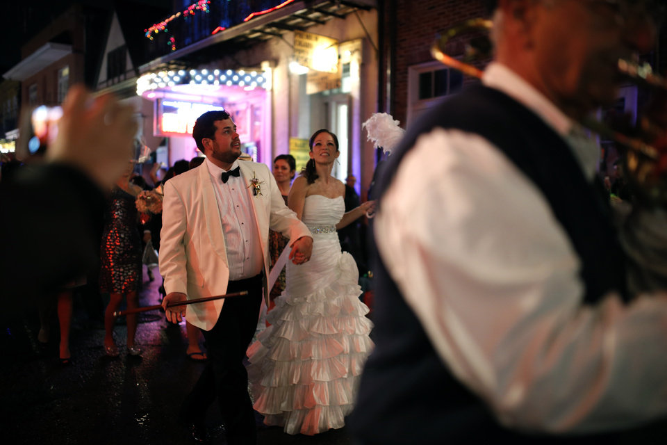 Photo - A jazz band leads a wedding party down Bourbon Street in the French Quarter New Year's Eve, Tuesday, Dec. 31, 2013 in New Orleans. Photo by Sarah Phipps, The Oklahoman