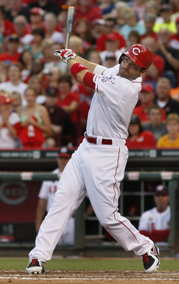 Photo - Cincinnati Reds' Joey Votto hits a one run double against the Milwaukee Brewers in the fifth inning of their baseball game in Cincinnati, Friday July 4, 2014. (AP Photo/Tom Uhlman)