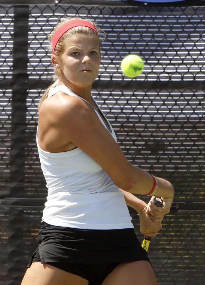 Photo - Bishop Kelley's Madison Westby plays her 6A final match against Southmoore's Jordan Henry during the Girls State Tennis Tournament at the OKC Tennis Center in Oklahoma City, OK, Saturday, May 10, 2014,  Photo by Paul Hellstern, The Oklahoman