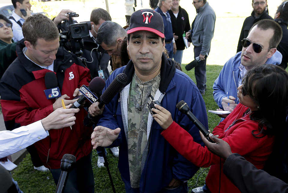 Pete Arias talks to the media about not being let back to his damaged home Saturday, April 20, 2013, three days after an explosion at a fertilizer plant in West, Texas. The massive explosion at the West Fertilizer Co. Wednesday night killed at least 14 people and injured more than 160. (AP Photo/Charlie Riedel)