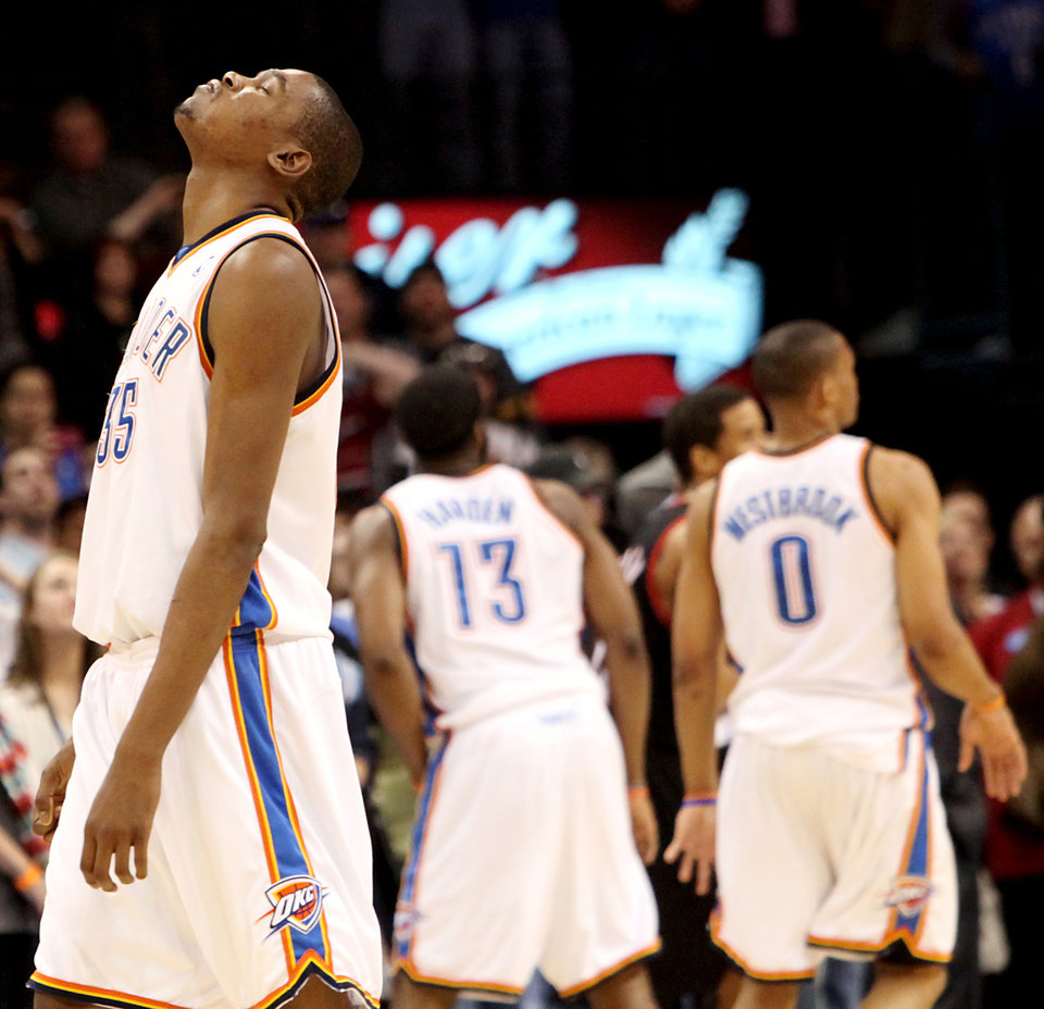 Photo - Oklahoma City's Kevin Durant reacts as he misses a three pointer in the final second against Portland during the second half of their NBA basketball game at the Ford Center in Oklahoma City, Okla., on Sunday, March 28, 2010. The Thunder lost to the Trail Blazers. Photo by John Clanton, The Oklahoman