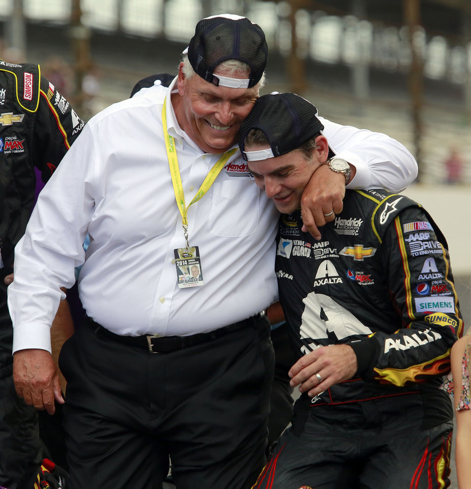 Photo - Jeff Gordon, right, celebrates with his team owner Rick Hendrick III after winning the NASCAR Brickyard 400 auto race at Indianapolis Motor Speedway in Indianapolis, Sunday, July 27, 2014.  (AP Photo/R Brent Smith)