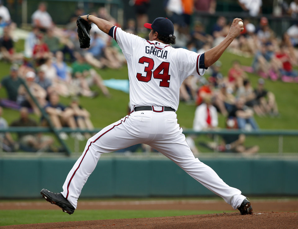 Photo - Atlanta Braves starting pitcher Freddy Garcia throws in the first inning of a spring exhibition baseball game against the Detroit Tigers, Wednesday, Feb. 26, 2014, in Kissimmee, Fla. (AP Photo/Alex Brandon)
