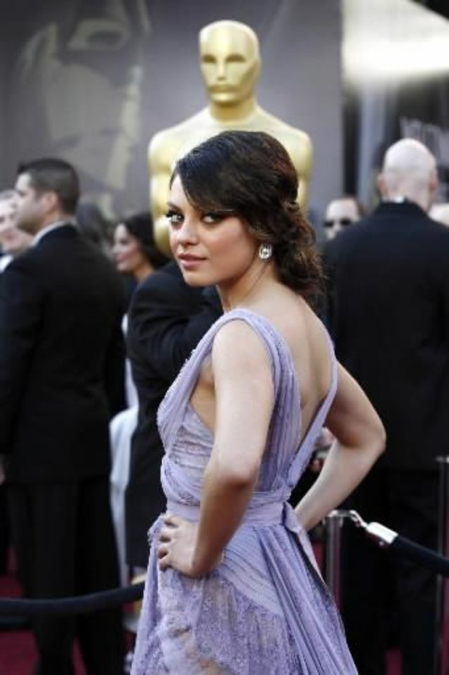 Mila Kunis arrives at the 83rd annual Academy Awards.
