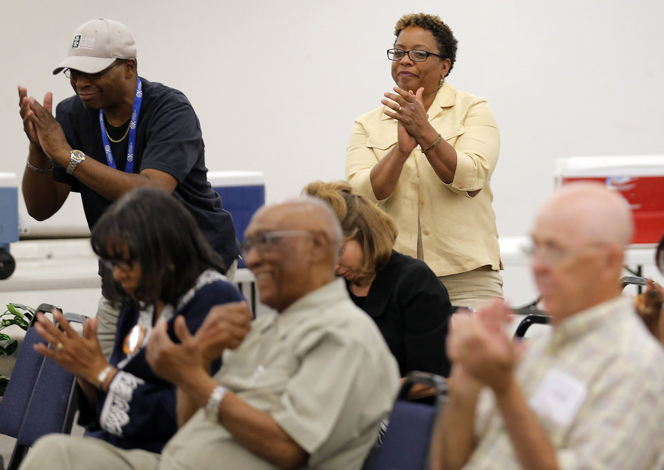 Melva Rich claps during a forum on State Question 759 at the OKC campus of Langston University, Thursday, Sept. 20, 2012. Photo by Sarah Phipps, The Oklahoman