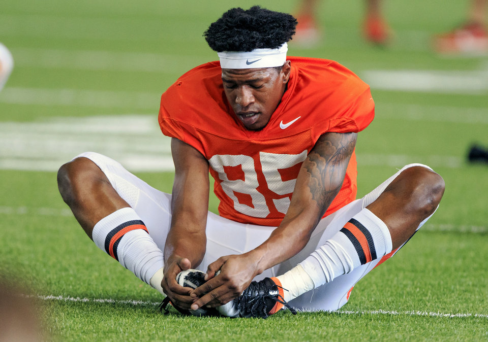 Photo - Oklahoma State University wide receiver Patrick McKaufman (85) stretches out at the start of OSU's team football practice at the Sherman Smith Practice Facility in Stillwater, Okla. on Tuesday, Aug. 7, 2018.    Photo by Chris Landsberger, The Oklahoman