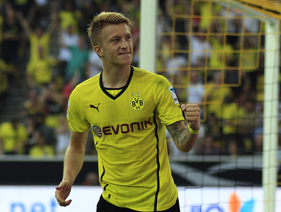 Photo - Dortmund's Marco Reus celebrates after scoring during the Supercup final soccer match between BvB Borussia Dortmund and Bayern Munich in Dortmund, Germany, Saturday, July 27, 2013. (AP Photo/Frank Augstein)