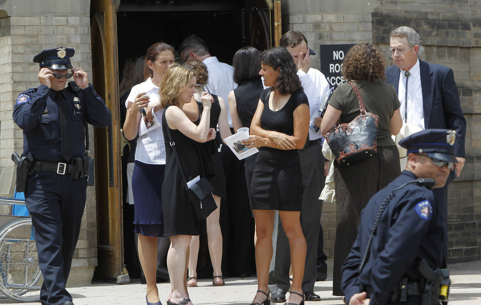 Photo -   People leave a memorial service for Gordon Cowden at the Pathways Church in Denver on Wednesday, July 25, 2012. Cowden was one of 12 people killed, and over 50 wounded in a shooting attack early Friday at the packed theater during a showing of the Batman movie,