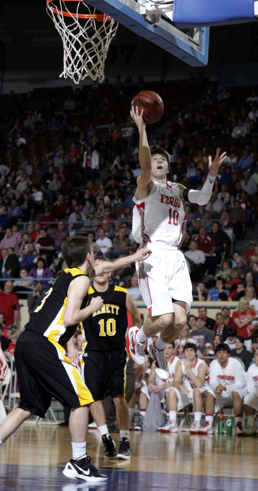 Photo - Forgan's Jake Regier shoots in front of Arnett's Trevor Bryant (3) and Cody Hunter (10) during the Class B boys state championship high school basketball game  at the State Fair Arena in Oklahoma City,  Saturday, March 3, 2012. Photo by Sarah Phipps, The Oklahoman