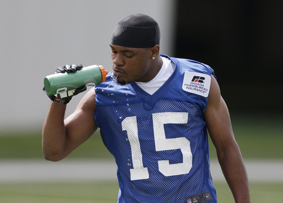 Photo - FILE - In this May 22, 2013 file photo, Indianapolis Colts' LaVon Brazill takes a drink of water during NFL football practice in Indianapolis. Brazill admitted  Monday, July 29, 2013 that his own