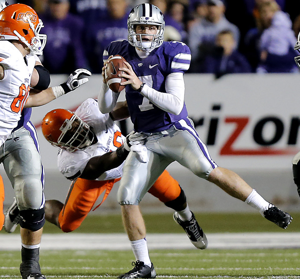Photo - Kansas State's Collin Klein (7) avoids the Oklahoma State rush during the college football game between the Oklahoma State University Cowboys (OSU) and the Kansas State University Wildcats (KSU) at Bill Snyder Family Football Stadium on Saturday, Nov. 1, 2012, in Manhattan, Kan. Photo by Chris Landsberger, The Oklahoman