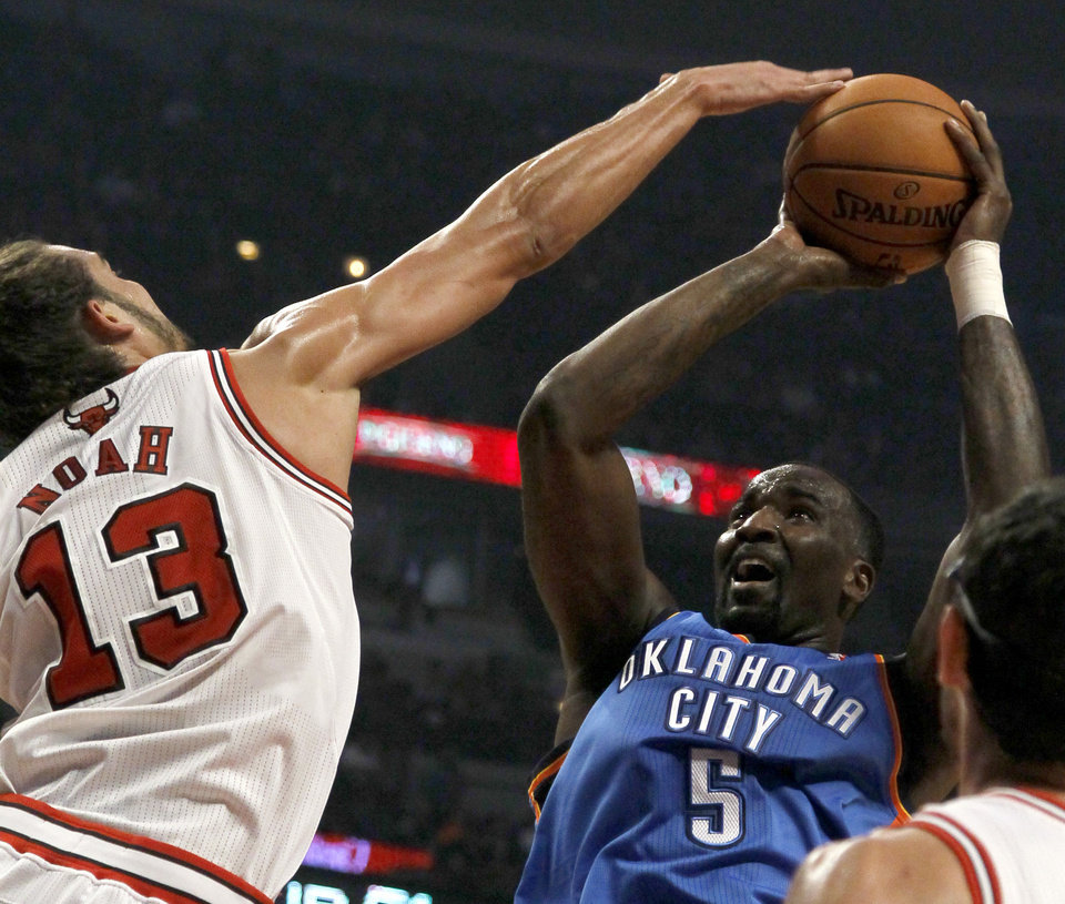 Photo - Chicago Bulls center Joakim Noah (13) blocks the shot of Oklahoma City Thunder center Kendrick Perkins during the first half of an NBA preseason basketball gam, Tuesday, Oct. 23, 2012, in Chicago. (AP Photo/Charles Rex Arbogast) ORG XMIT: CXA104