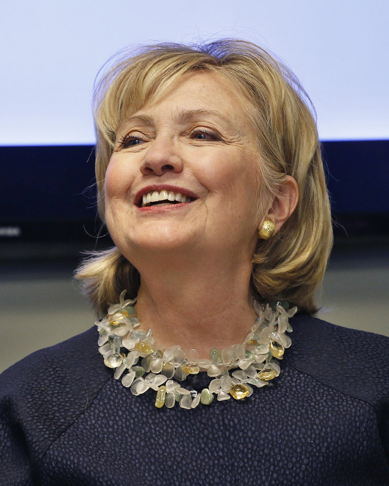 """FILE - This June 2, 2014, file photo shows Hillary Clinton smiling during a meeting with community leaders after touring Intertech Plastics in Denver. The former Secretary of State said in an interview with ABC News Sunday, June 8, 2014, that she will decide whether to run for president again """"when it feels right for me to decide."""" For now she says she is focused on promoting her new book and helping fellow Democrats in the mid-term elections in the fall. Clinton says potential Democratic rivals are free to choose what they would like to do. (AP Photo/Brennan Linsley, File)"""