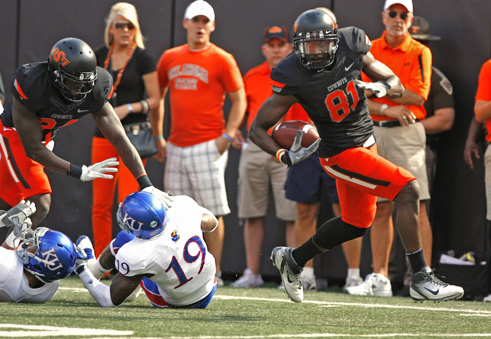 Photo - Oklahoma State's Justin Blackmon (81) scores during he first quarter of a college football game between the Oklahoma State University Cowboys (OSU) and the University of Kansas Jayhawks (KU) at Boone Pickens Stadium in Stillwater, Okla., Saturday, Oct. 8, 2011 Photo by Steve Sisney, The Oklahoman