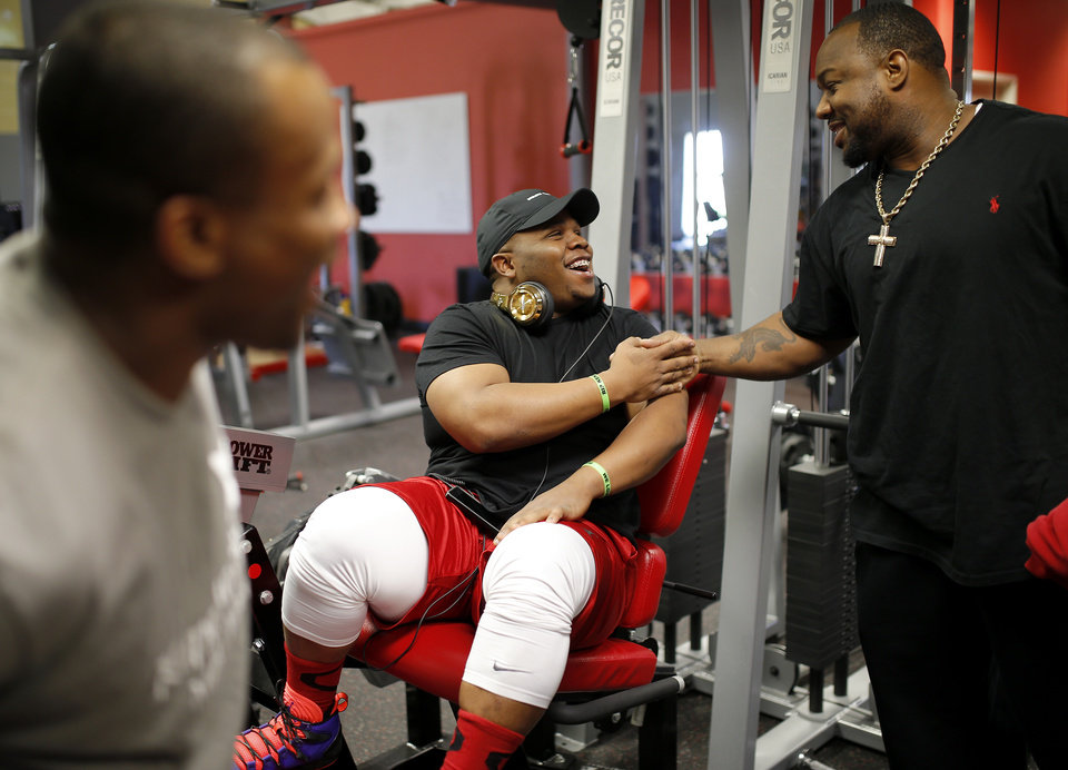 Photo - Ray Westbrook is greeted by Nicolaus Broom after arriving at a gym in Oklahoma City to workout, Tuesday, April 16, 2014. Photo by Bryan Terry, The Oklahoman