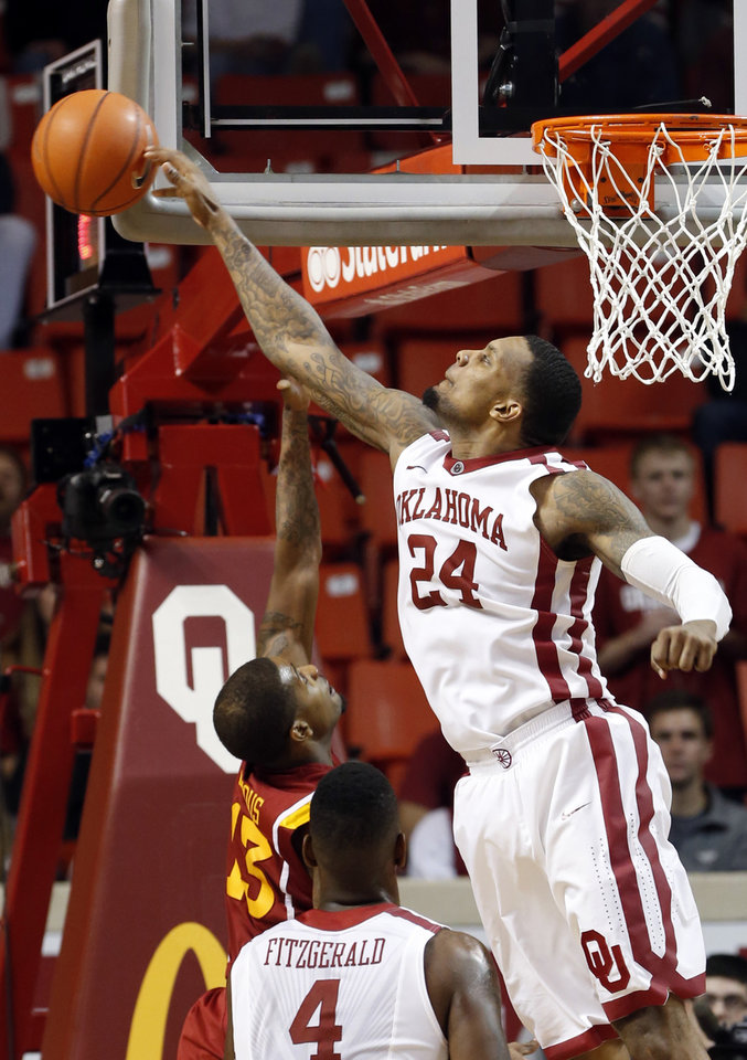 Photo - Oklahoma's Romero Osby (24) blocks a shot by Iowa State Cyclone's Korie Lucious (13) in the second half as the University of Oklahoma Sooners (OU) men defeat the Iowa State Cyclones 86-69 in NCAA, college basketball at Lloyd Noble Center on Saturday, March 2, 2013  in Norman, Okla. Photo by Steve Sisney, The Oklahoman