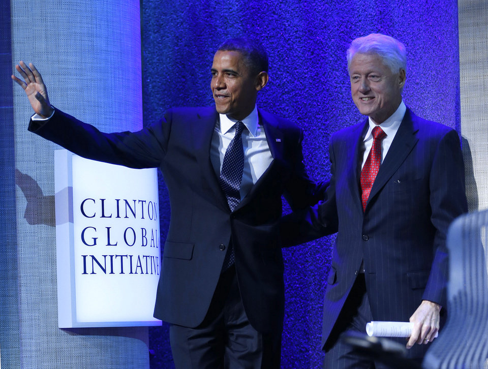 Photo -   President Barack Obama and former President Bill Clinton arrive prior to President Obama speech at the Clinton Global Initiative Annual meeting in New York, Tuesday, Sept. 25, 2012. (AP Photo/Pablo Martinez Monsivais)