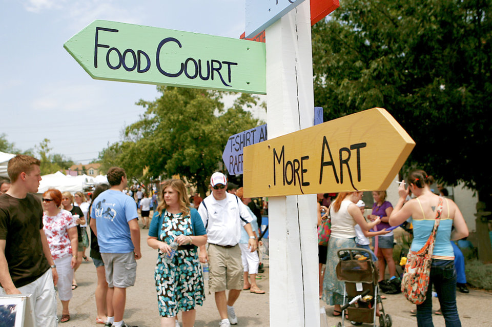 Photo - Signs direct visitors Sunday at the 34th annual Paseo Arts Festival in Oklahoma City. Photos by John Clanton, The Oklahoman