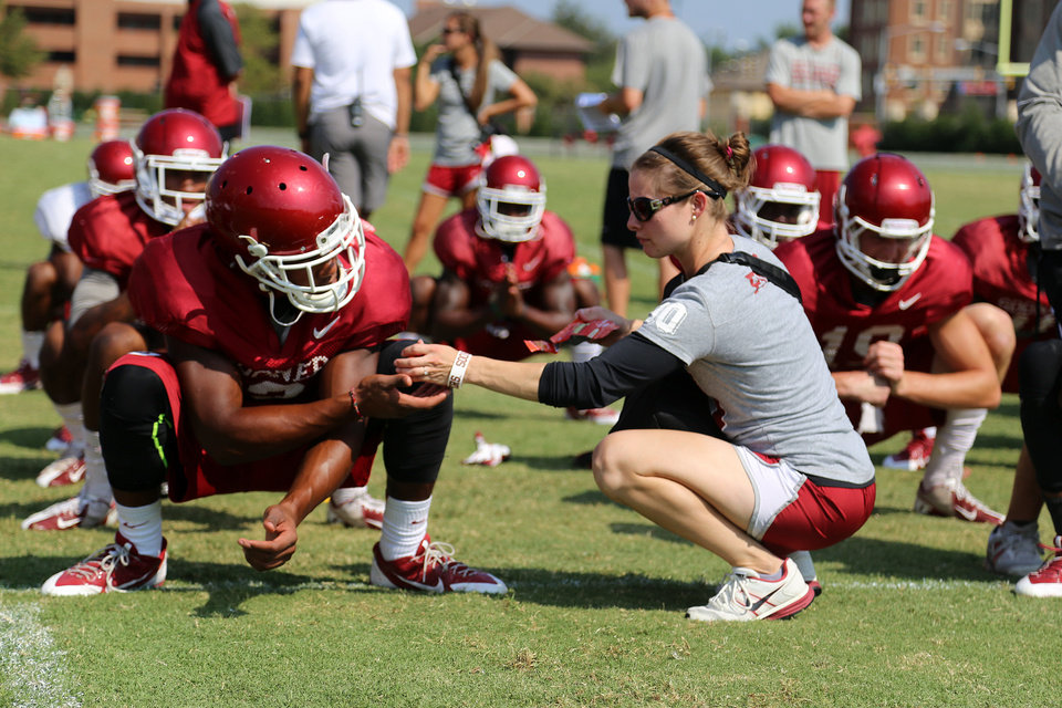 Photo - OU director of Sports Nutrition Tiffany Byrd talks to players during a recent practice. PHOTO BY ANDREW LENTZ, Courtesy OU Athletics Communications