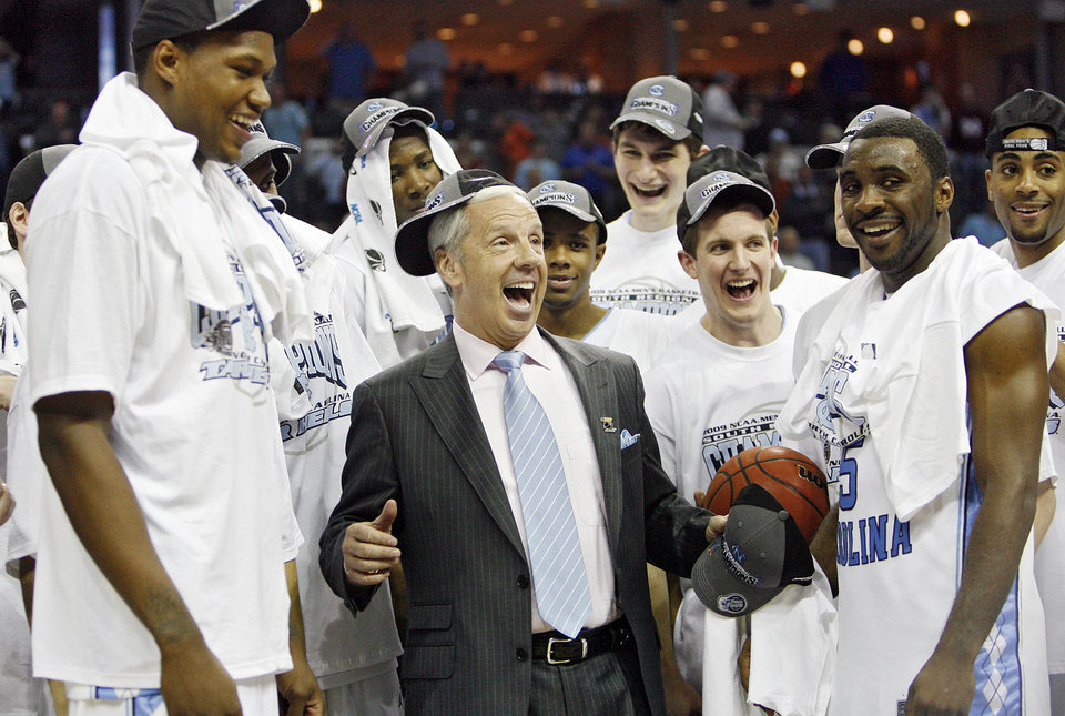 North Carolina\'s Roy Williams celebrates with his team after the 72-60 win over Oklahoma in the Elite Eight game of NCAA Men\'s Basketball Regional between the University of North Carolina and the University of Oklahoma at the FedEx Forum on Sunday, March 29, 2009, in Memphis, Tenn. PHOTO BY CHRIS LANDSBERGER, THE OKLAHOMAN
