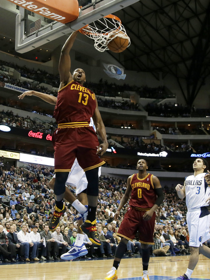 Photo - Cleveland Cavaliers' Tristan Thompson (13) dunks after getting past Dallas Mavericks' Brandan Wright, rear, as C.J. Miles (0) and Shane Larkin (3) watch in the first half of an NBA basketball game, Monday, Feb. 3, 2014, in Dallas. (AP Photo/Tony Gutierrez)
