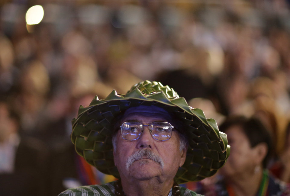 Photo - Hawaii delegate Albert Lewis watches a video presentation during the Democratic National Convention in Charlotte, N.C., on Tuesday, Sept. 4, 2012. (AP Photo/David Goldman)  ORG XMIT: DNC783