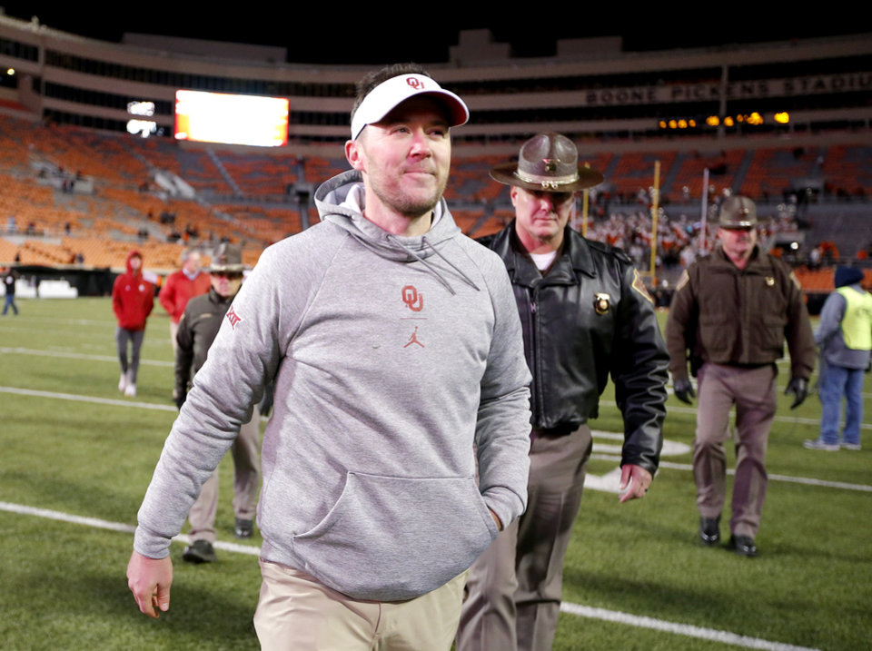 Photo - Oklahoma head coach Lincoln Riley walks to the fans following the Bedlam college football game between the Oklahoma State Cowboys (OSU) and Oklahoma Sooners (OU) at Boone Pickens Stadium in Stillwater, Okla., Saturday, Nov. 30, 2019. OU won  34-16. [Sarah Phipps/The Oklahoman]