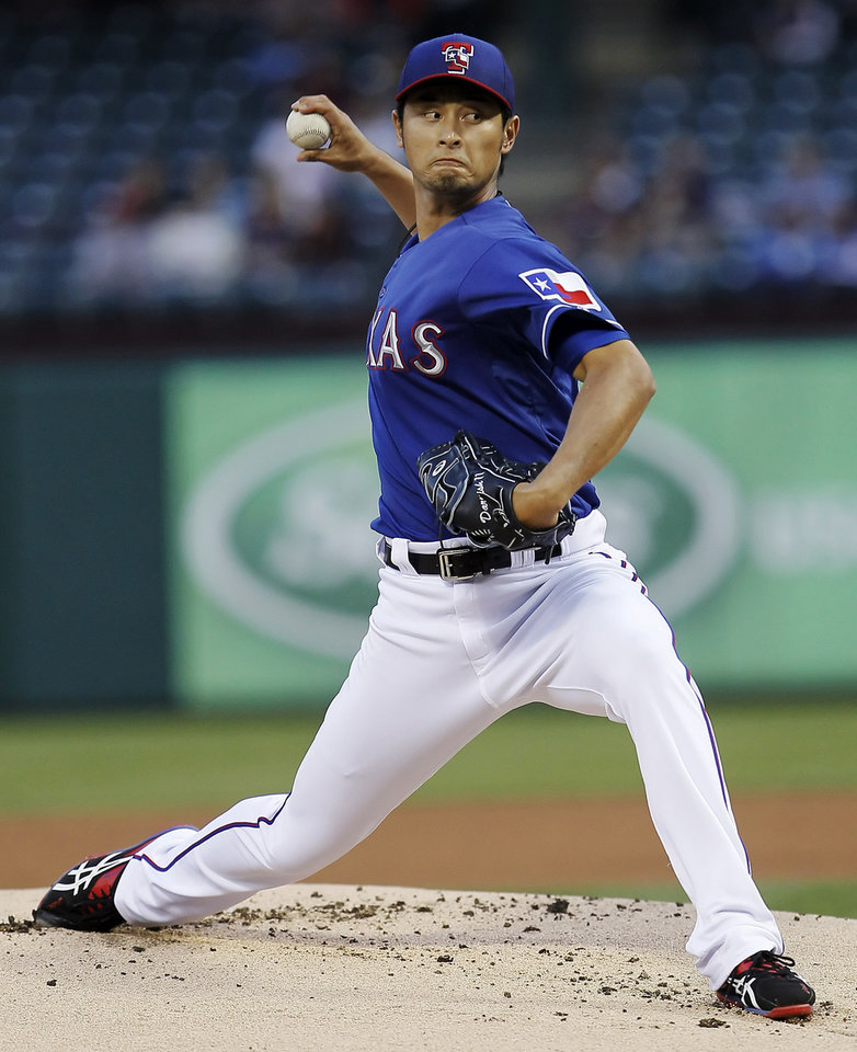 Texas Rangers starting pitcher Yu Darvish (11) delivers to the Mexico City Red Devils during the first inning of a spring training exhibition baseball game, Thursday, March 28, 2013, in Arlington, Texas. (AP Photo/The Fort Worth Star-Telegram, Brandon Wade)  MAGS OUT; (FORT WORTH WEEKLY, 360 WEST); INTERNET OUT