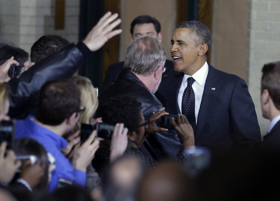 Photo - President Barack Obama arrives to speak at the Union Depot in St. Paul, Minn., Wednesday, Feb. 26, 2014, where he announced a new competition encouraging investments for job creation and infrastructure as part of his