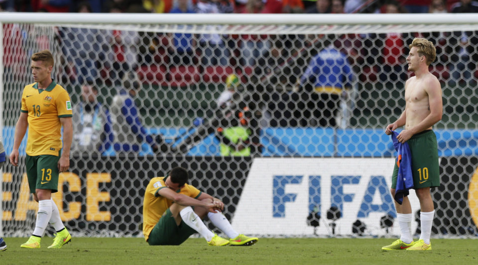 Photo - Australian players react after the group B World Cup soccer match between Australia and the Netherlands at the Estadio Beira-Rio in Porto Alegre, Brazil, Wednesday, June 18, 2014.  The Netherlands won the match 3-2. (AP Photo/Wong Maye-E)