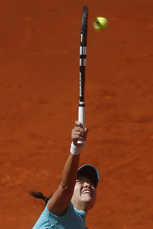 Photo - Li Na from China serves during a Madrid Open tennis tournament match against Jie Zheng from China, in Madrid, Spain, Tuesday, May 6, 2014. (AP Photo/Andres Kudacki)