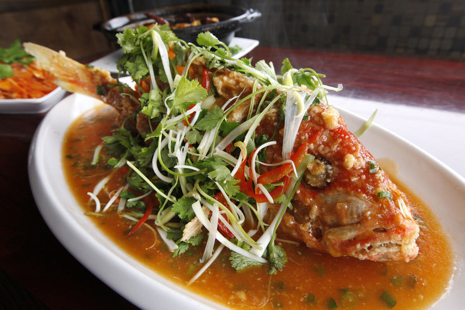 Crispy Whole Red Snapper in Sweet and Sour Sauce at the Szechuan Bistro in Oklahoma City. <strong>PAUL B. SOUTHERLAND - THE OKLAHOMAN</strong>