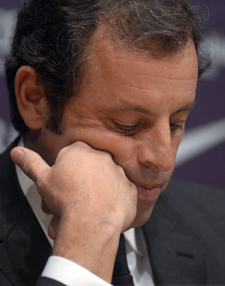 Photo - FC Barcelona's president Sandro Rosell, looks down during a press conference at the Camp Nou stadium in Barcelona, Spain, Thursday, Jan 23, 2014. Sandro Rosell is stepping down as president of Barcelona a day after a judge agreed to hear a lawsuit accusing him of allegedly hiding the cost of the transfer of Brazil striker Neymar. Rosell says he is resigning after an emergency meeting with Barcelona's board of directors on Thursday. Rosell says vice president Josep Bartomeu will take his place as president and finish the term that expires in 2016. Elected in 2010 to replace outgoing president Joan Laporta, Rosell said last April he planned to run for re-election in 2016. (AP Photo/Manu Fernandez)
