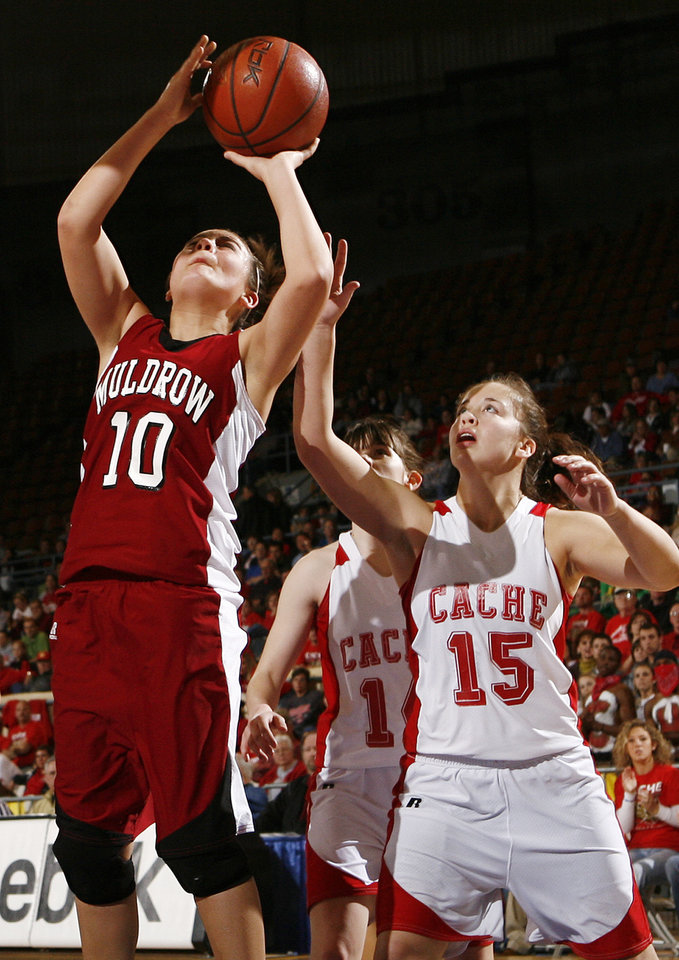 Photo - Muldrow's Fallon Tate (10) shoots the ball in front of Kaley Tartsah (15) of Cache during 4A girls semifinal game between Muldrow and Cache in the Oklahoma High School Basketball Championships at State Fair Arena in Oklahoma City, Friday, March 13, 2009. PHOTO BY NATE BILLINGS, THE OKLAHOMAN