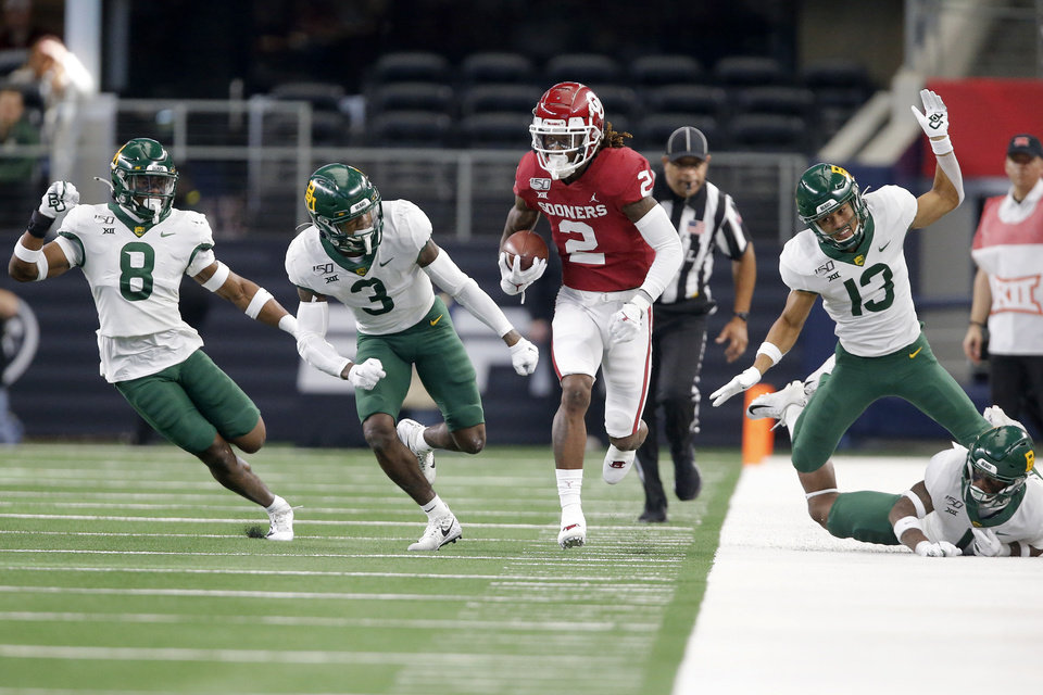 Photo - Oklahoma's CeeDee Lamb (2) runs after a reception during the Big 12 Championship Game between the University of Oklahoma Sooners (OU) and the Baylor University Bears at AT&T Stadium in Arlington, Texas, Saturday, Dec. 7, 2019. [Bryan Terry/The Oklahoman]